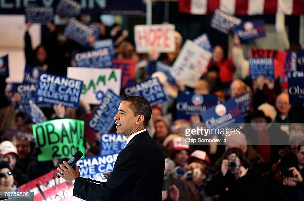 Democratic presidential hopeful Sen Barack Obama addresses a rally at the Pan Am Flight Services hanger January 4 2008 in Portsmouth New Hampshire...