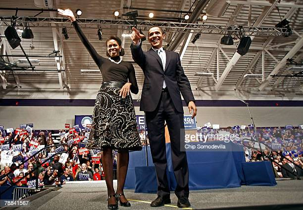 Democratic presidential hopeful Sen Barack Obama and his wife Michelle Obama take the stage at a primary night rally in the gymnasium at the Nashua...