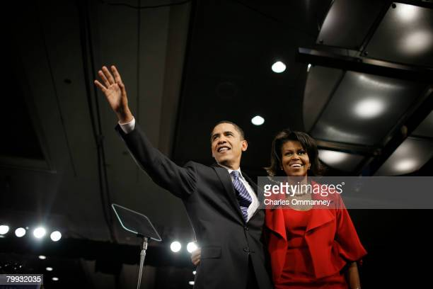 Democratic presidential hopeful Sen Barack Obama and his wife Michelle Obama greet supporters during a Super Tuesday primary campaign rally at the...