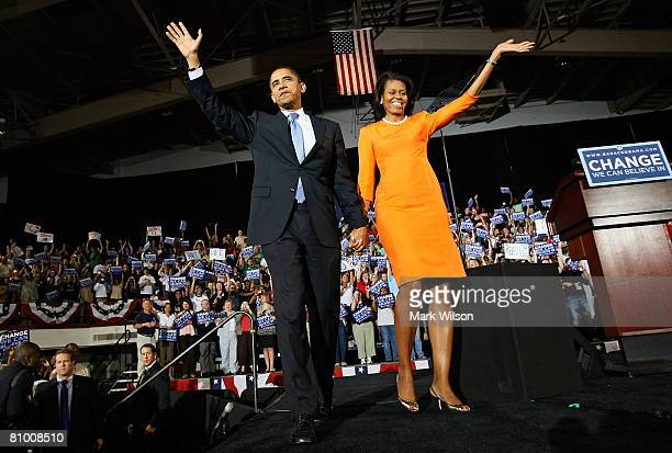 Democratic presidential hopeful Sen. Barack Obama and his wife Michelle Obama greet the crowd after speaking during a rally at the North Carolina...