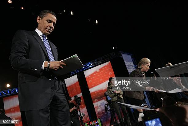 Democratic presidential hopeful Sen Barack Obama and Sen Hillary Clinton sign autographs after their debate at Cleveland State University's Wolstein...