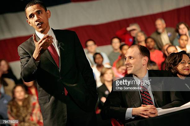 Democratic presidential hopeful Sen Barack Obama answers questions from the audience as economic advisor Austan Goolsbee listens during a campaign...
