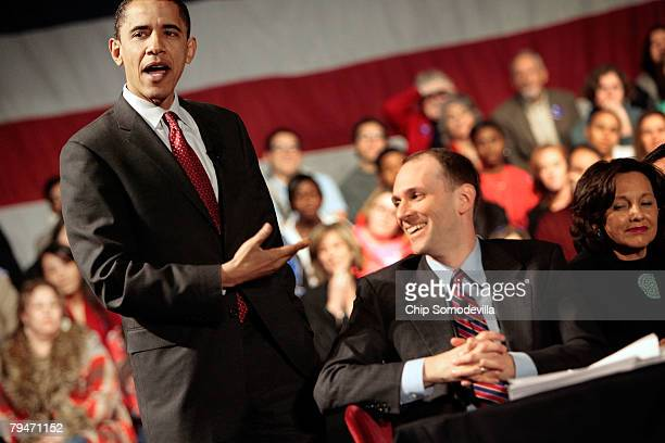 Democratic presidential hopeful Sen Barack Obama gestures to economic advisor Austan Goolsbee as Obama answers questions from audience members during...