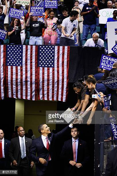 Democratic presidential hopeful Sen Barack Obama greets people during a Broward County campaign rally at the Bank Atlantic Center May 23 2008 in...