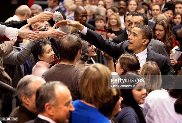 Democratic presidential hopeful Sen Barack Obama greets supporters during a rally of about 14000 people at the Taco Bell Arena at Boise State...