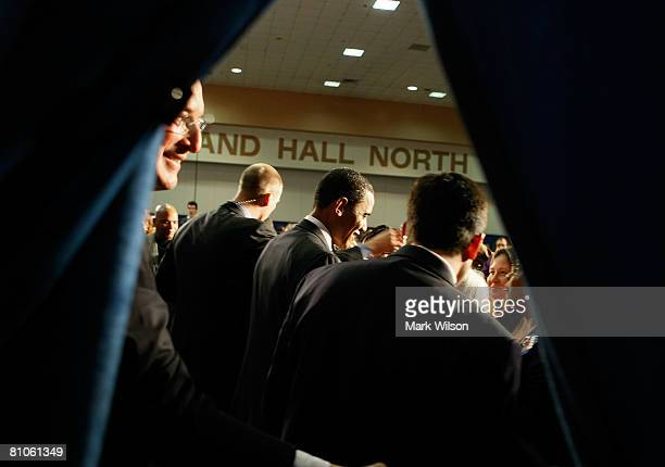 Democratic presidential hopeful Sen. Barack Obama is flanked by Secret Service agents and joined by Sen. Jay Rockefeller while greeting supporters...