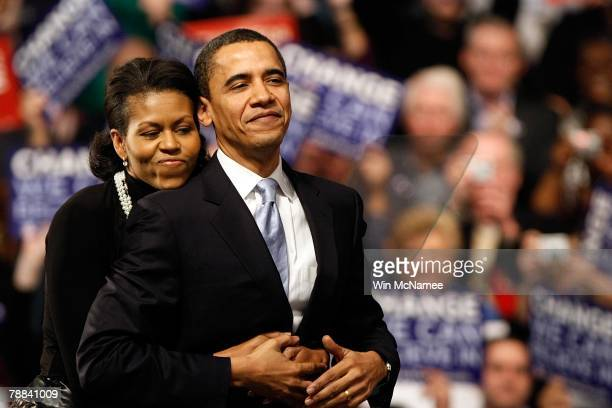 Democratic presidential hopeful Sen. Barack Obama is hugged by his wife Michelle Obama before his speech at a primary night rally in the gymnasium at...