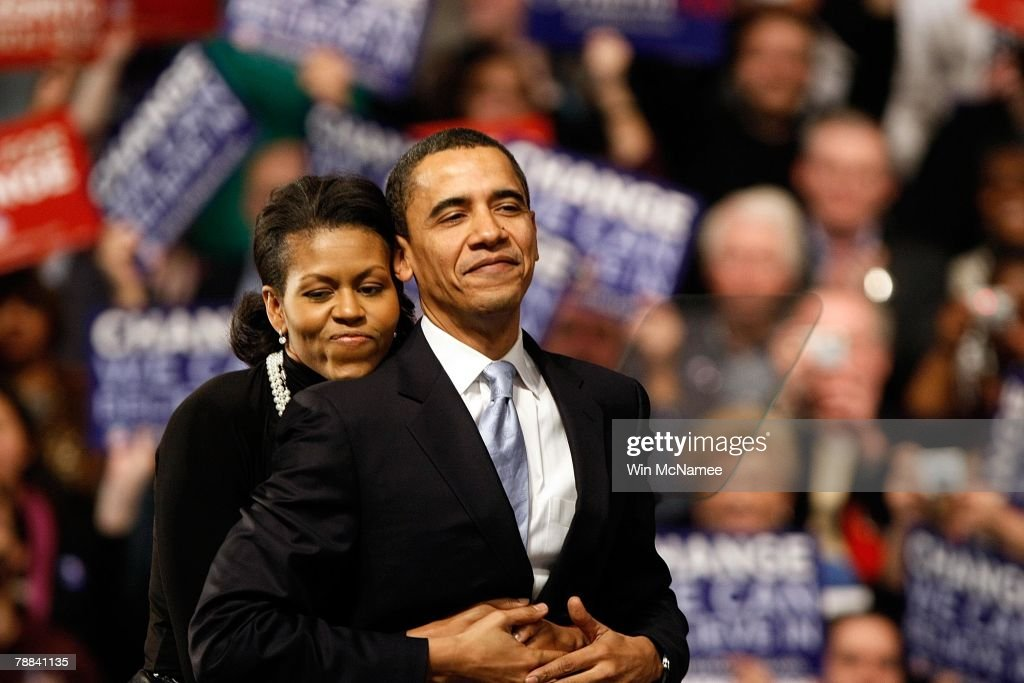 Democratic presidential hopeful Sen. Barack Obama (D-IL) is hugged by his wife Michelle Obama before his speech at a primary night rally in the gymnasium at the Nashua South High School on January 8, 2008 in Nashua, New Hampshire. Obama finished a projected 2nd place behind Sen. Hillary Clinton (D-NY) in the nation's first democratic primary