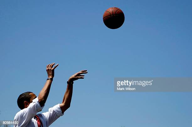 Democratic presidential hopeful Sen Barack Obama shoots a basketball on the court at Riverview Elementry School May 4 2008 in Elkhart Indiana Voters...