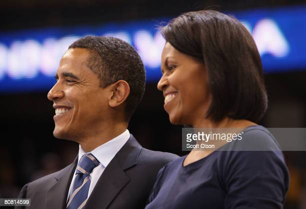 Democratic presidential hopeful Sen Barack Obama waits to be introduced with his wife Michelle Obama at a rally at the University of Pittsburgh April...