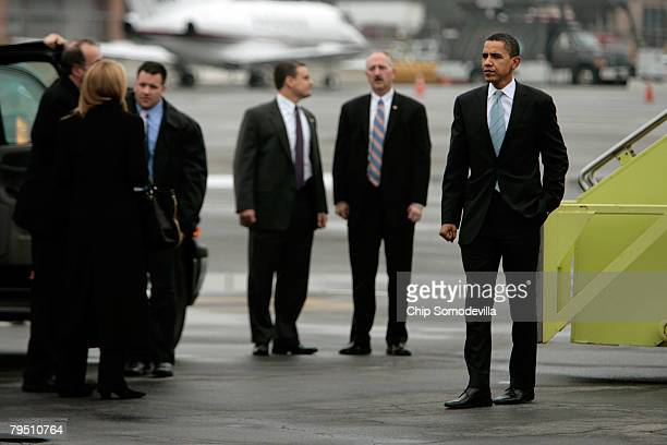Democratic presidential hopeful Sen Barack Obama waits to board his plane on the tarmac during the last full day of campaigning before Super Tuesday...