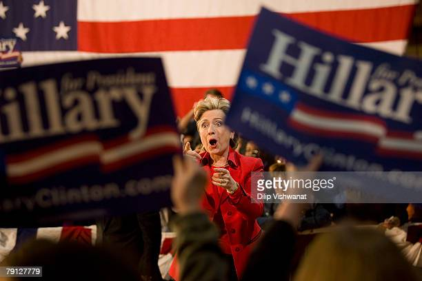 Democratic presidential hopeful Sen Hillary Clinton acknowledges the crowd at a town hall meeting following the Nevada caucus at McCluer North High...
