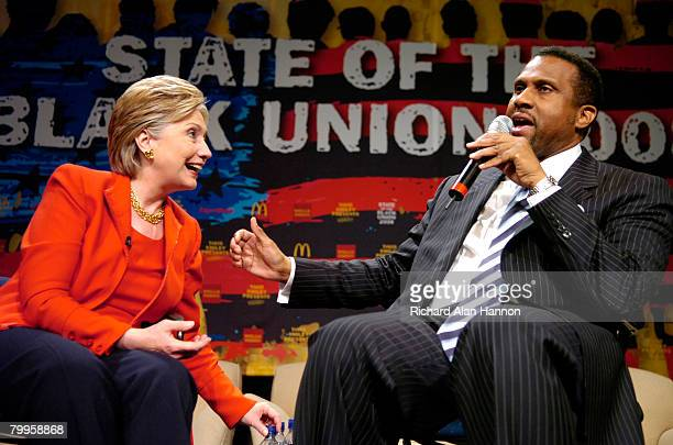 Democratic presidential hopeful Sen Hillary Clinton along with television talk show host Tavis Smiley speaks to the crowd at the 'State Of The Black...