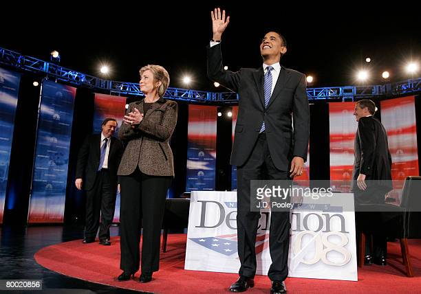 Democratic presidential hopeful Sen Hillary Clinton and Sen Barack Obama wave to the audience before they participate in a debate while NBC's Meet...