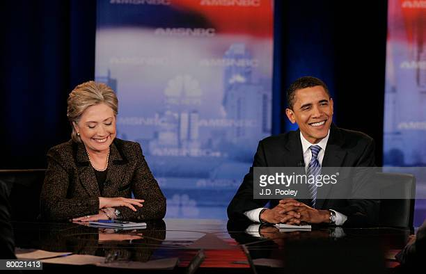 Democratic presidential hopeful Sen Hillary Clinton and Sen Barack Obama smile as they participate in a debate at Cleveland State University's...