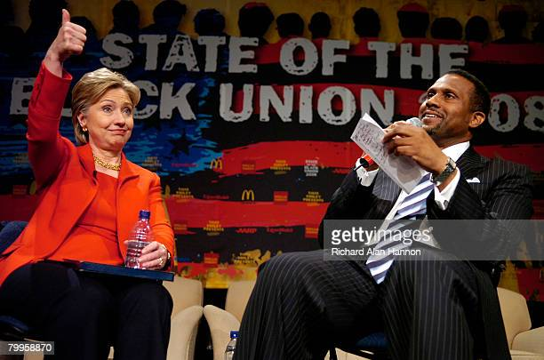 Democratic presidential hopeful Sen Hillary Clinton gives the thumbs up as she sits with television talk show host Tavis Smiley while speaking to the...