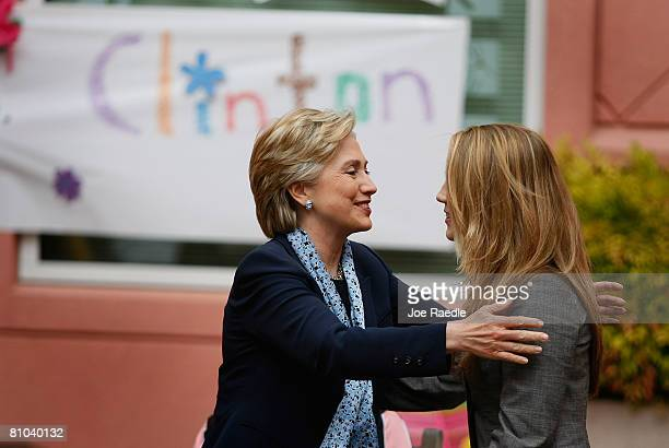 Democratic presidential hopeful Sen. Hillary Clinton hugs Jordan Kokich as she is introduced during a round table discussion on health care at...