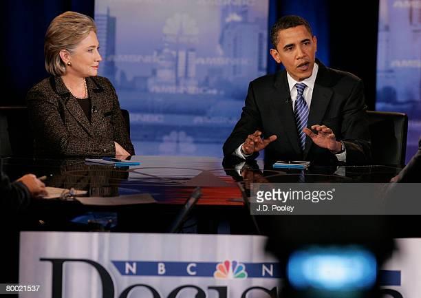 Democratic presidential hopeful Sen Hillary Clinton looks on as Sen Barack Obama speaks during a debate at Cleveland State University's Wolstein...