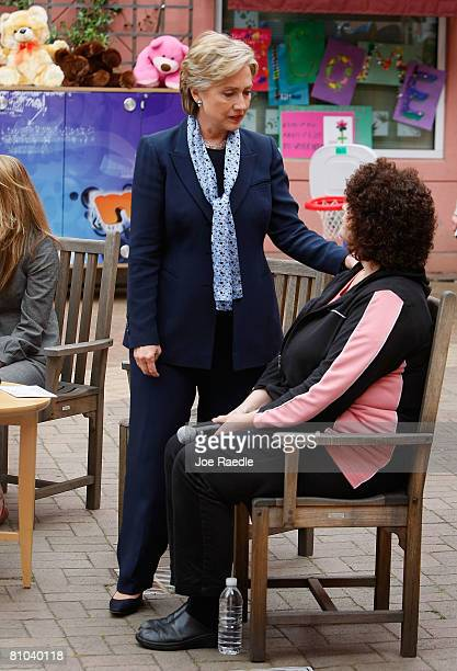 Democratic presidential hopeful Sen. Hillary Clinton sits with Bridget Sheffler during a round table discussion on health care at Doernbecher...