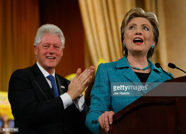 Democratic presidential hopeful Sen Hillary Clinton speaks as former US president Bill Clinton looks on during a primary night rally in the Park...