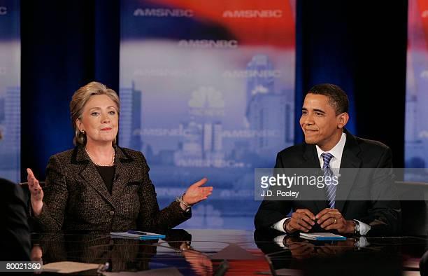 Democratic presidential hopeful Sen Hillary Clinton speaks as Sen Barack Obama smiles during a debate at Cleveland State University's Wolstein Center...