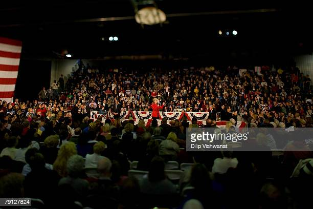 Democratic presidential hopeful Sen Hillary Clinton speaks while Former President Bill Clinton looks on at a town hall meeting following the Nevada...