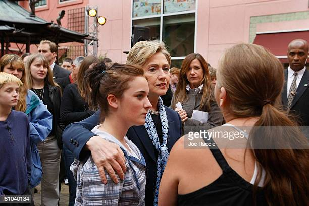 Democratic presidential hopeful Sen. Hillary Clinton speaks with people during a round table discussion on health care at Doernbecher Children's...