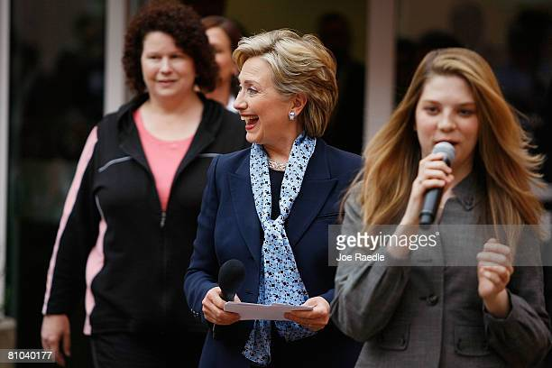 Democratic presidential hopeful Sen. Hillary Clinton walks in with Jordan Kokich and Bridget Sheffler during a round table discussion on health care...