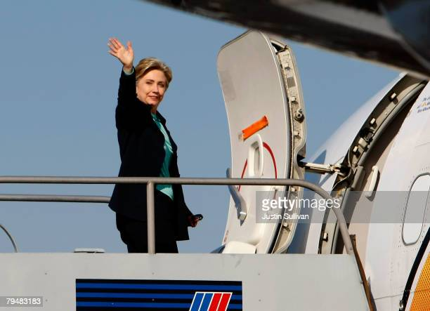 Democratic presidential hopeful Sen Hillary Clinton waves as she boards her plane February 2 2008 in Burbank California Clinton is campaigning...