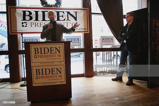 Democratic Presidential hopeful Sen Joe Biden fields questions as his son Hunter Biden looks on at a campaign stop at 180 Main Pub and Restaurant...