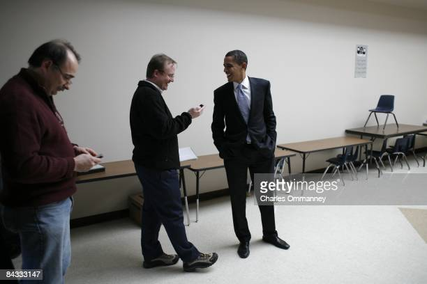 Democratic Presidential hopeful Senator Barack Obama backstage at a campaign stop with senior advisors David Axlerod and Robert Gibbs December 29...