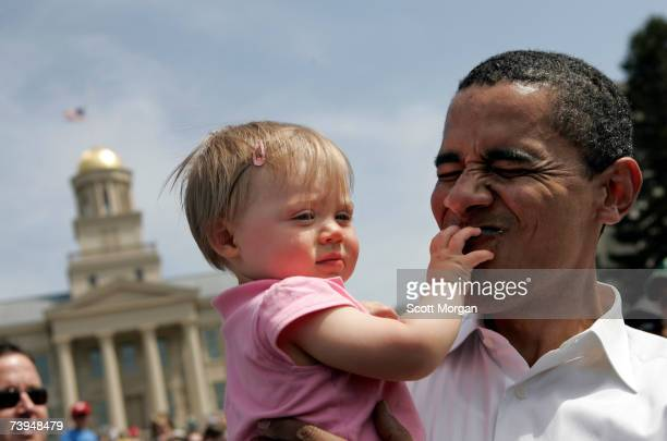 Democratic presidential hopeful Senator Barack Obama holds 10monthold Claire Von Bergen of Iowa City while shaking hands with supporters after...