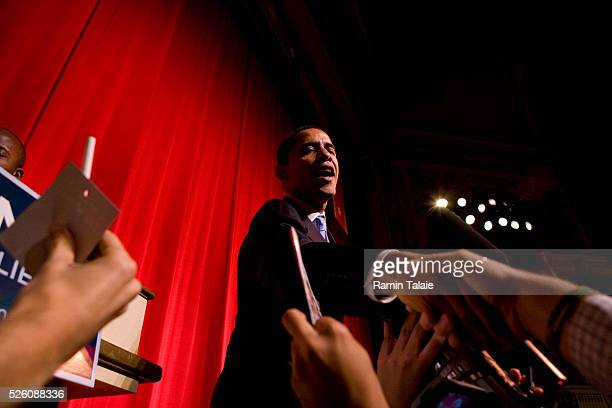 Democratic presidential hopeful Senator Barack Obama of Illinois, greets supporters at the end of a fundraiser event at the Apollo Theater in New...