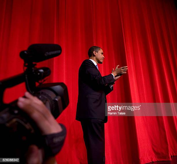Democratic presidential hopeful Senator Barack Obama of Illinois, acknowledges his supporters at the end of a fundraiser event at the Apollo Theater...
