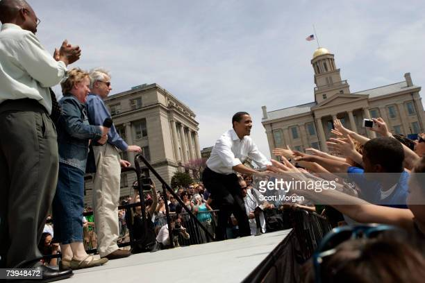 Democratic presidential hopeful Senator Barack Obama shakes hands with supporters before speaking in front of the Old Capitol on the Pentacrest at...