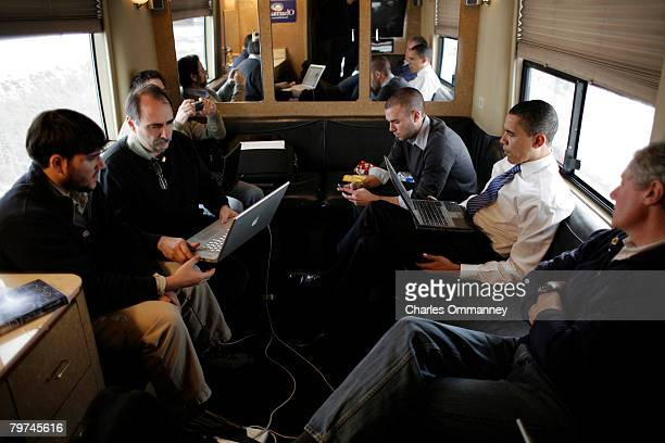 EXCLUSIVE Democratic presidential hopeful Senator Barack Obama talks with his senior aides and makes phone calls aboard his campaign bus December 31...