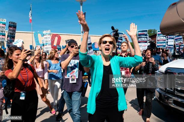 Democratic presidential hopeful Senator Elizabeth Warren greets supporters as she arrives at a rally outside the building where the Wing Ding Dinner...
