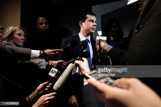Democratic presidential hopeful South Bend, Indiana mayor Pete Buttigieg speaks to the media at the National Action Network's annual convention on...