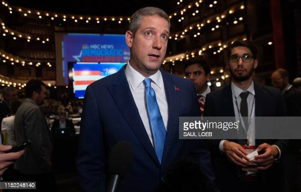 Democratic presidential hopeful US Representative for Ohio's 13th congressional district Tim Ryan speaks to the press in the Spin Room after...