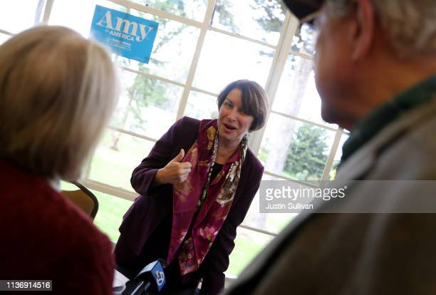 Democratic presidential hopeful US Sen Amy Klobuchar greets attendees during a roundtable discussion on climate change on March 19 2019 in San...