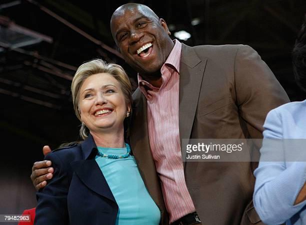 Democratic presidential hopeful US Sen Hillary Clinton hugs former basketball player Earvin 'Magic' Johnson during a rally at California State Los...