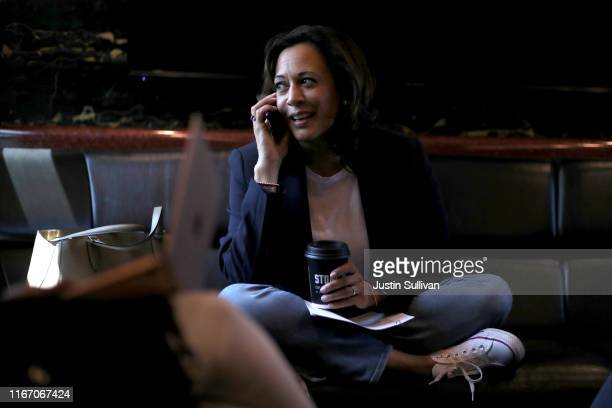 Democratic presidential hopeful U.S. Sen. Kamala Harris talks on the phone as she rides on her campaign bus to a campaign event in Storm Lake on...