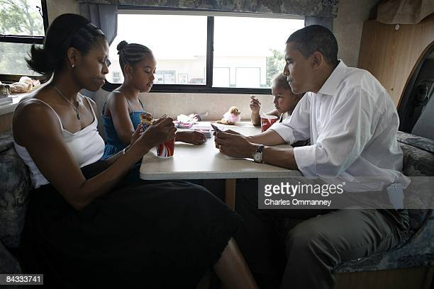 Democratic presidential hopeful US Senator Barack Obama his wife Michelle and two daughters Sasha and Malia play cards in their RV July 4 2007 on a...