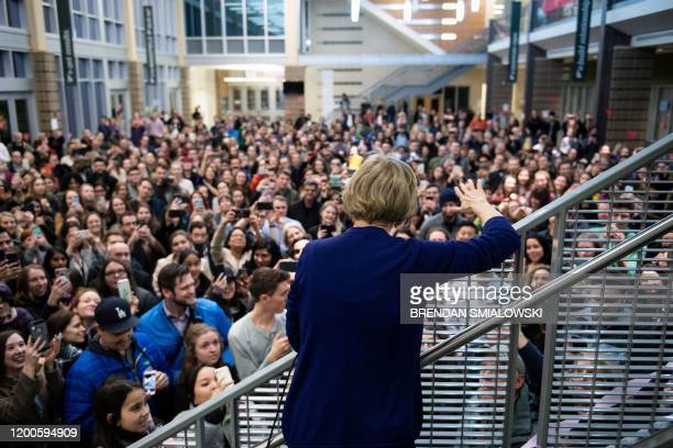 Democratic presidential hopeful US Senator Elizabeth Warren speaks to an overflow crowd from the stairs before a rally at Wakefield High School,...