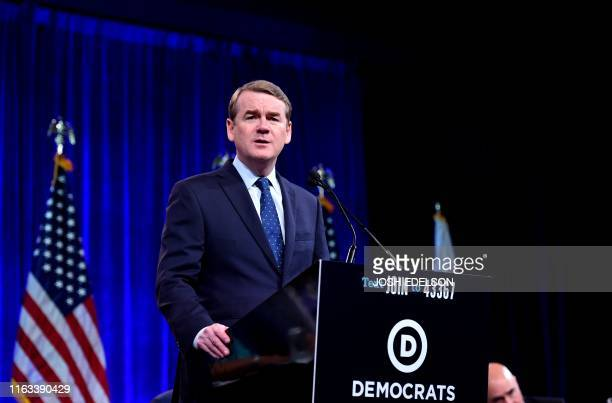 Democratic Presidential hopeful US Senator for Colorado Michael Bennet speaks onstage during the Democratic National Committee's summer meeting in...