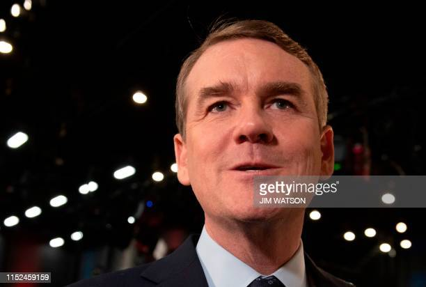 Democratic presidential hopeful US Senator for Colorado Michael Bennet speaks to the press in the Spin Room after participating in the second...