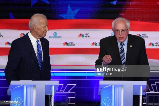 Democratic presidential hopeful US Senator for Vermont Bernie Sanders speaks as former US Vice President Joseph R Biden looks on during the second...