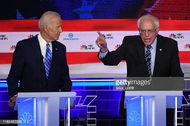 Democratic presidential hopeful US Senator for Vermont Bernie Sanders speaks alongside former US Vice President Joseph R Biden Jr during the second...
