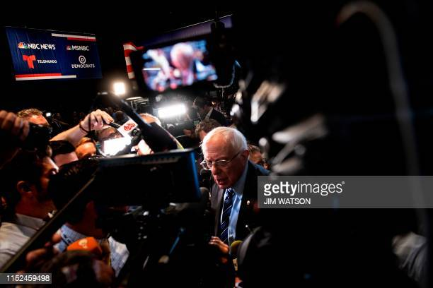 TOPSHOT Democratic presidential hopeful US Senator for Vermont Bernie Sanders speaks to the press in the Spin Room after the second Democratic...