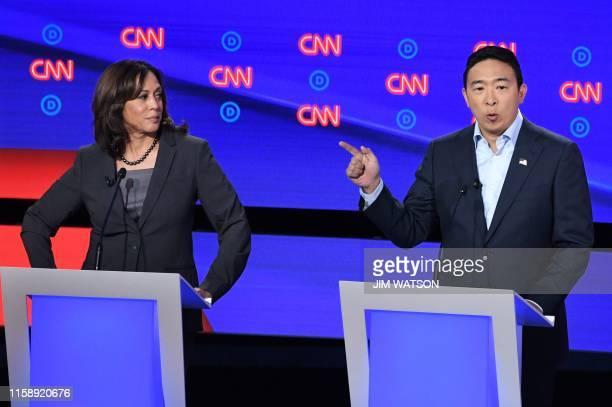 Democratic presidential hopeful US Senator from California Kamala Harris looks on as US entrepreneur Andrew Yang speaks during the second round of...